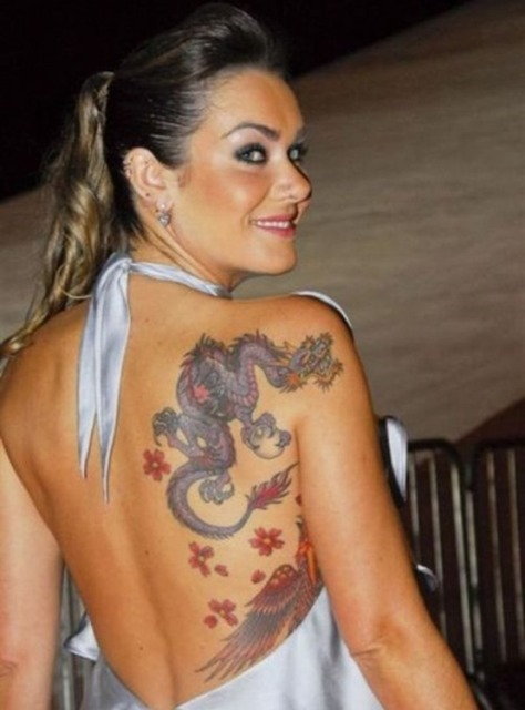 Dragon and red flowers tattoo on the back