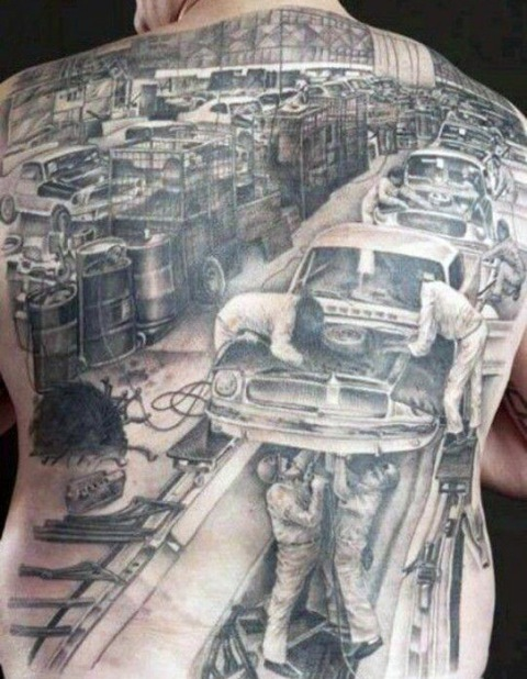 Car repair shop tattoo on the whole back