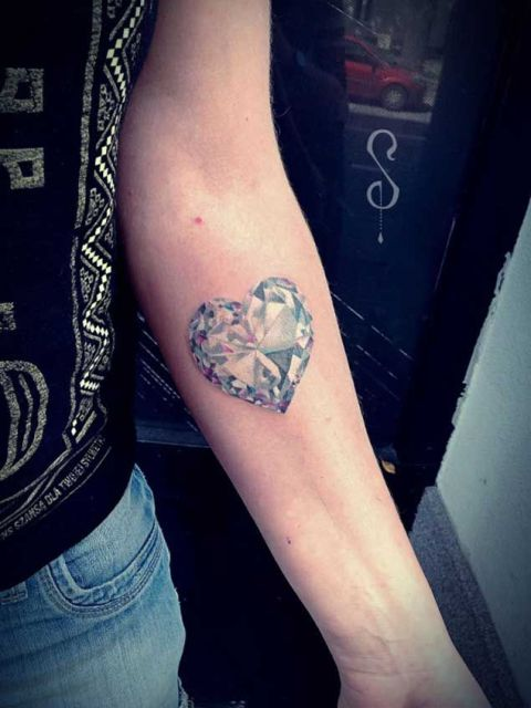 Heart shaped diamond tattoo on the forearm