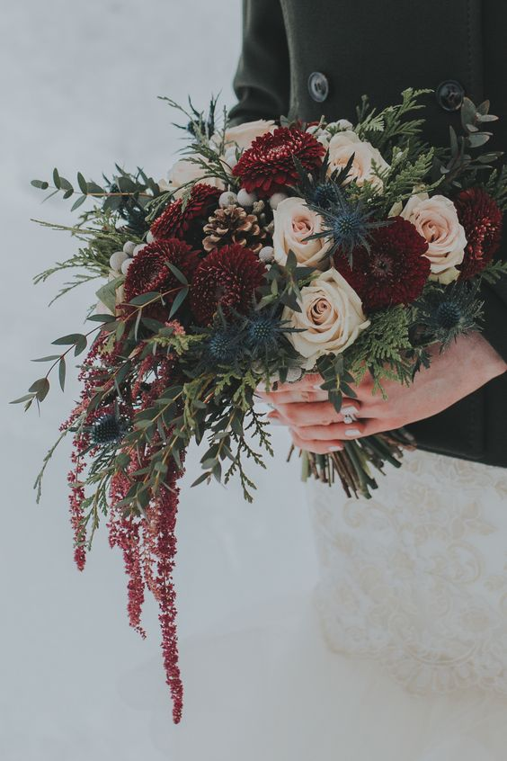 bouquet with hanging burgundy amaranthus, pomponis, silver brunia, thistles, blush roses and winter foliage