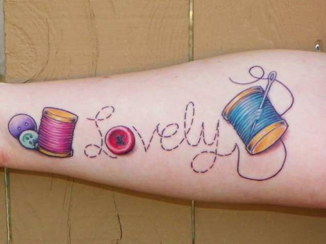Colorful threads, needle and buttons tattoo