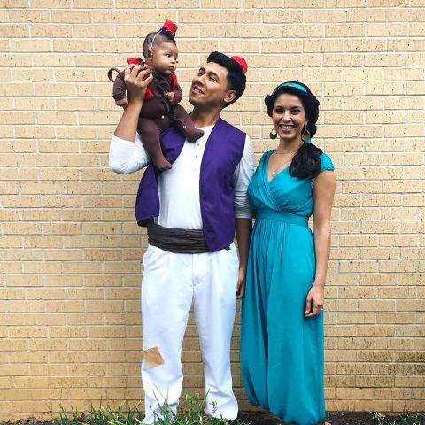 Aladdin costume for the dad, Jasmine costume for the mom and Abu costume for the kid