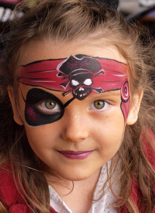 girl's pirate makeup with a painted headband and eyeband