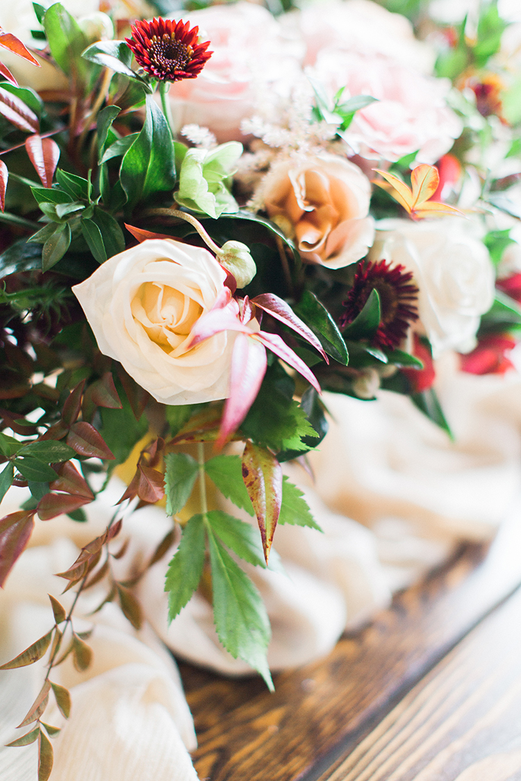pink rose centerpieces - http://ruffledblog.com/winery-vow-renewal-inspiration-with-autumn-leaves
