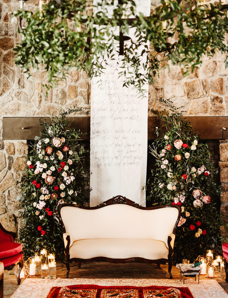 The ceremony space was beautifully decorated with lush blooms, calligraphy and candles