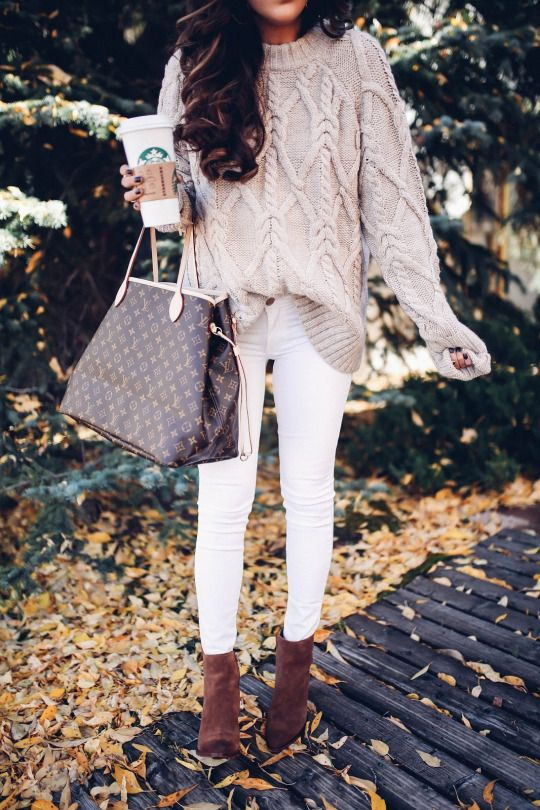 a neutral oversized sweater, white jeans, brown suede booties and a large bag