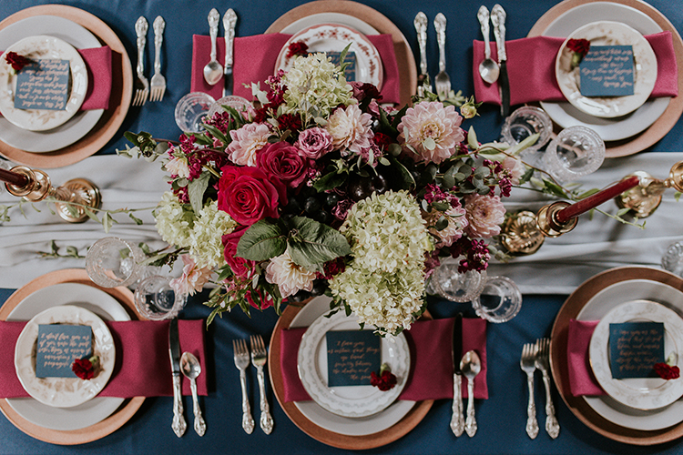 vintage inspired red and blue tablescapes - http://ruffledblog.com/artist-inspired-wedding-ideas-with-oxblood-and-navy