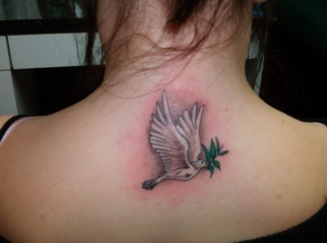Dove and greenery tattoo on the back