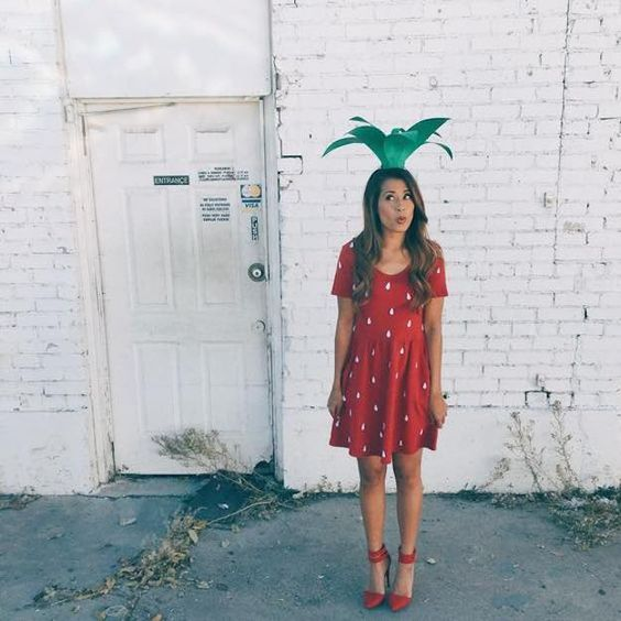 strawberry costume with a red polka dot dress, red ankle strap shoes and a crazy paper hat