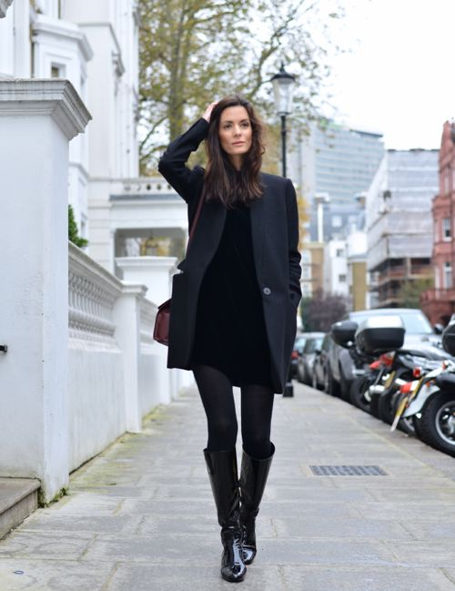 a mini black dress, a graphite grey coat, tall boots and black tights