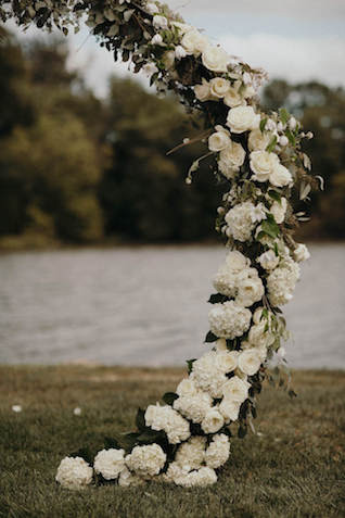 Floral wreath wedding ceremony arch