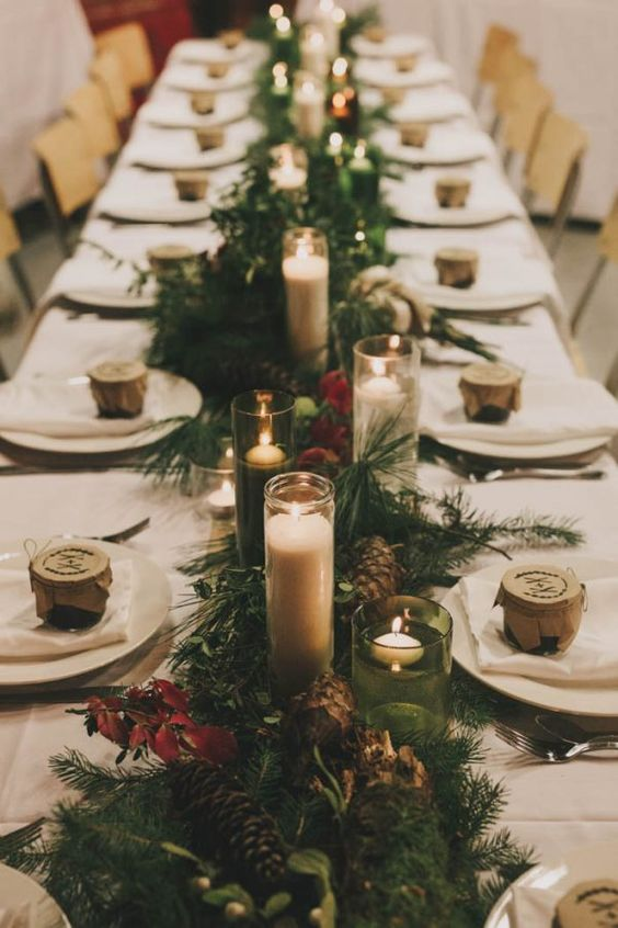 evergreens, pinecones, red leaves and lots of candles for a forest winter wedding