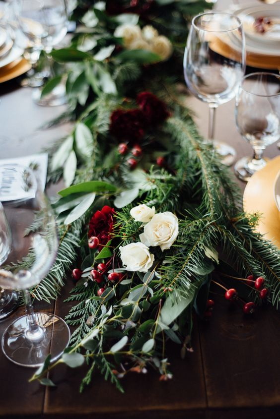 foliage, evergreens, white roses and winterberry table runner will make your space cozier