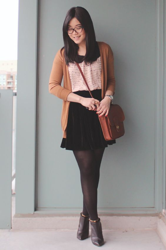 black pointed toe boots, black tights, a blush top, a black velvet skirt and a long cardigan