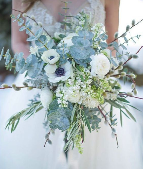 a pale bouquet with pale eucalyptus, white blooms, greenery for an icy feel