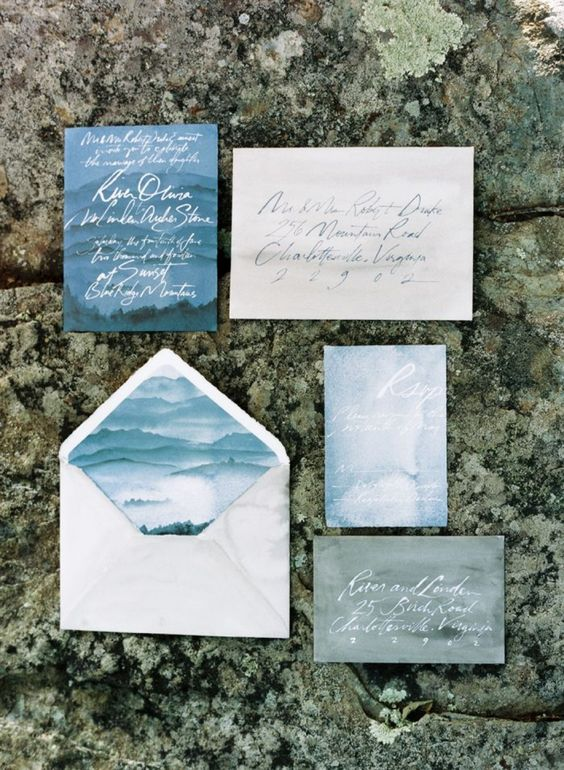 a coastal wedding invitation suite in the shades of blue and greyand calligraphy looks moody and dreamy