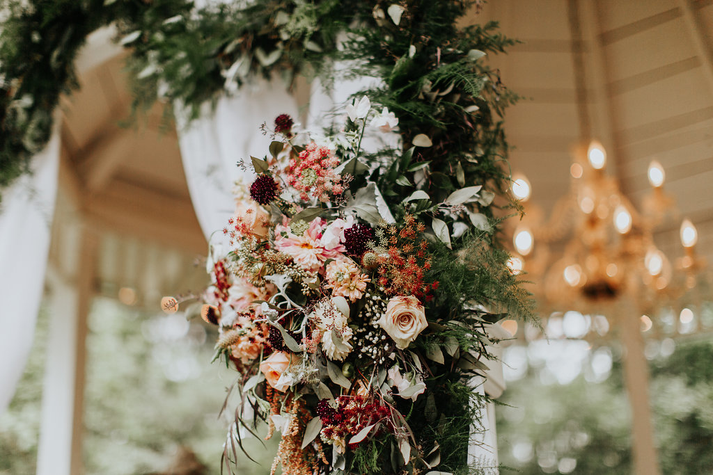 tropical inspired wedding flowers for the ceremony - http://ruffledblog.com/glam-autumn-wedding-at-belle-gardens