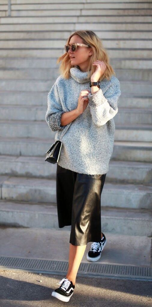 a black midi skirt, a grey oversized sweater and black Vans sneakers for a comfy look