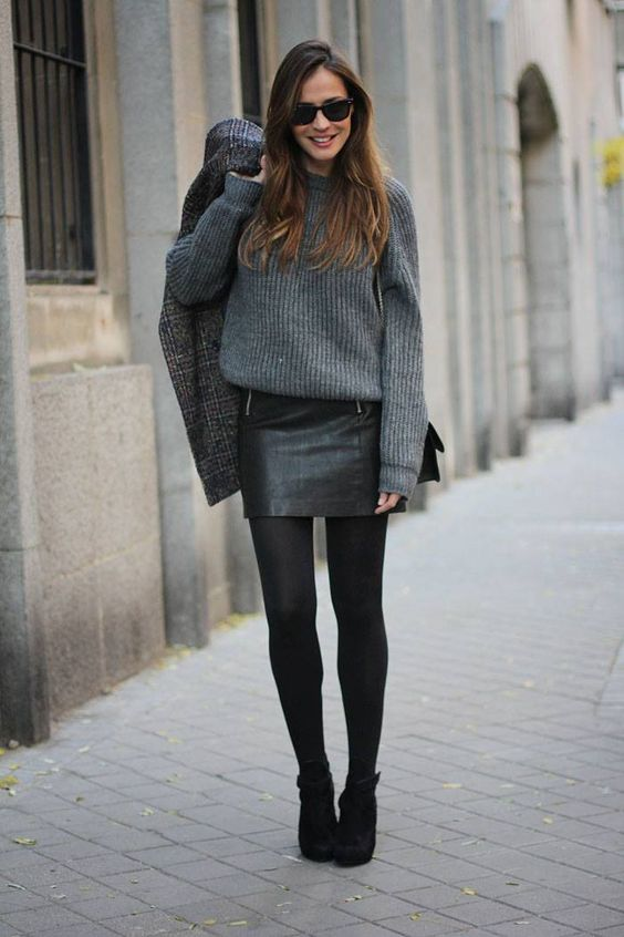 a grey sweater, a black mini skirt, black tights and black suede booties for a cute look