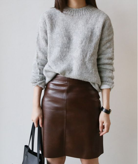 a maroon leather skirt and a grey sweater can be worn to work if there's no strict dress code