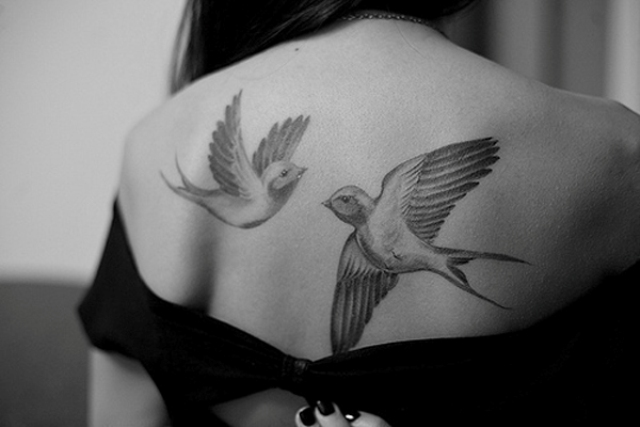 Two tattoos on the back