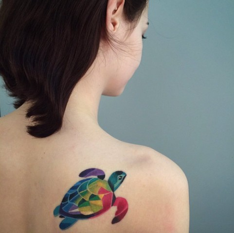 Colorful turtle tattoo design on the shoulder