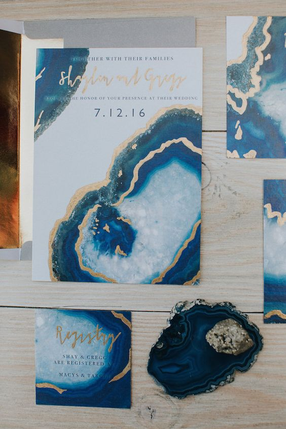 geode and gem-inspired wedidng invitation suite in shades of blue and gold for a trendy feel