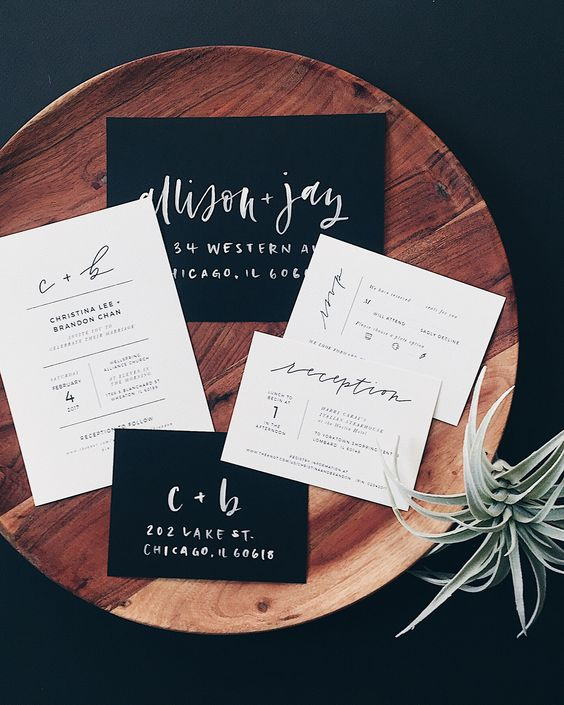 black and white wedidng invitations with modern letters for minimalist weddings