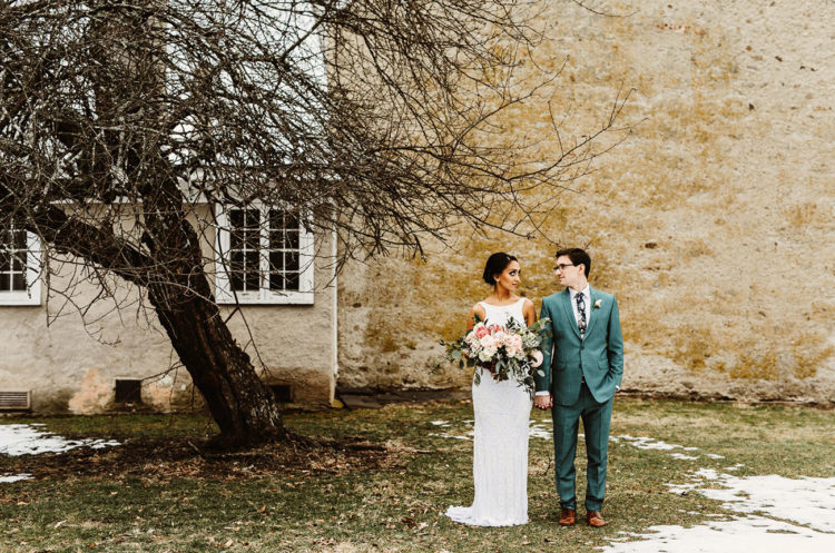 After that the couple dressed up into more European clothes - the groom was wearign a seafoam green suit and the bride was wearing a modern wedding gown