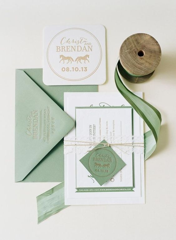 sage green and white wedding invites with twine and pressed letters for a simple spring wedding