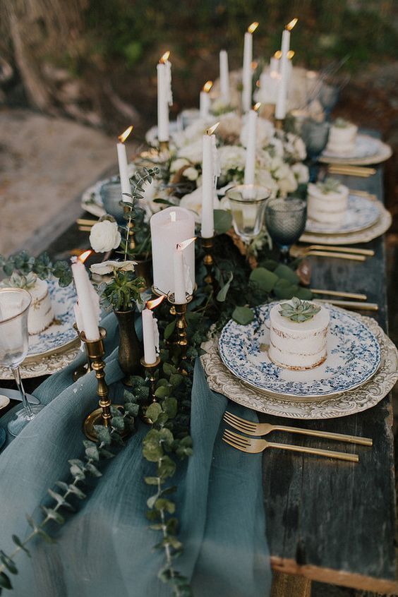 a muted blue table runner with eucalyptus for a winter coastal wedding