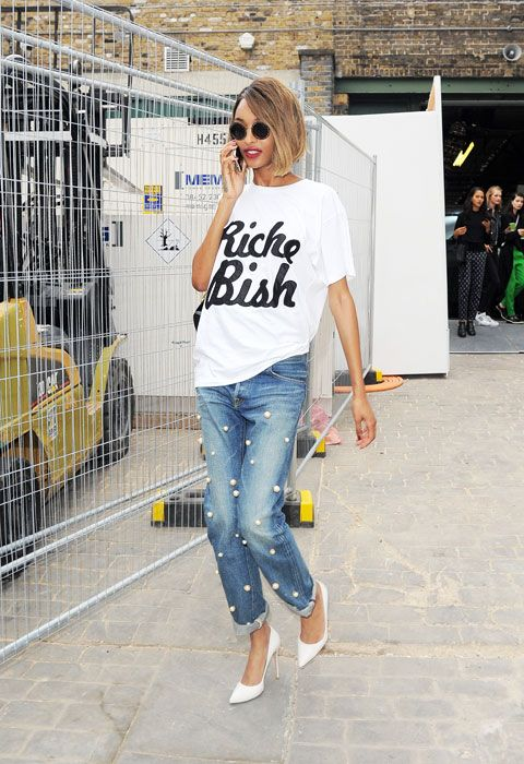 an oversized printed tee, blue cuffed jeans with large pearls and white shoes
