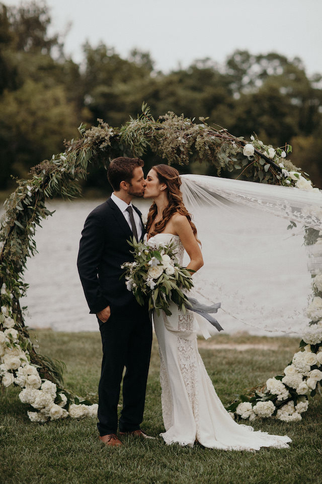 Floral adorned wedding arch