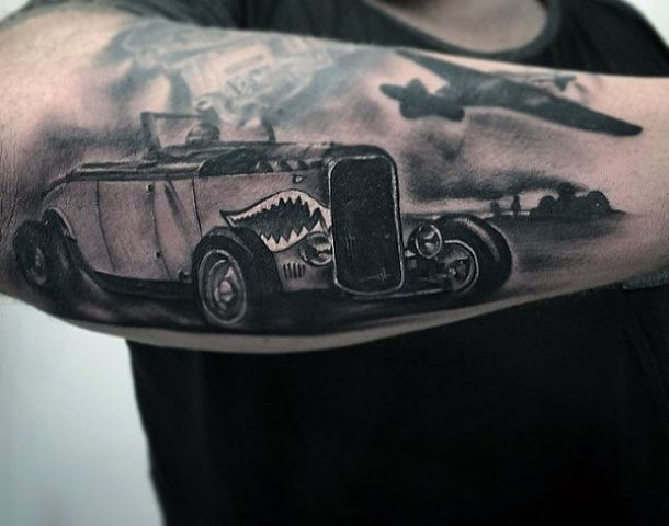 Car and plane tattoo on the forearm