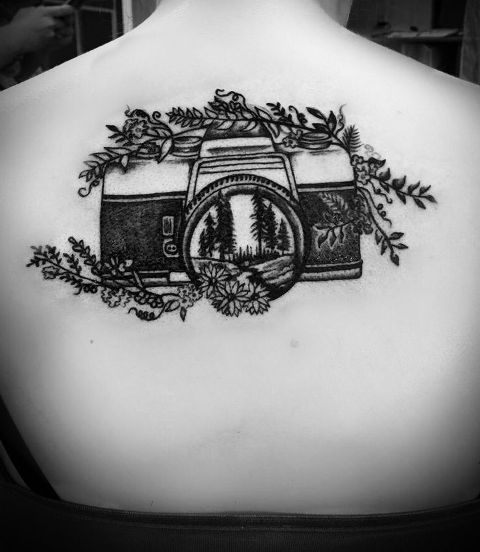 Camera and flowers tattoo on the back