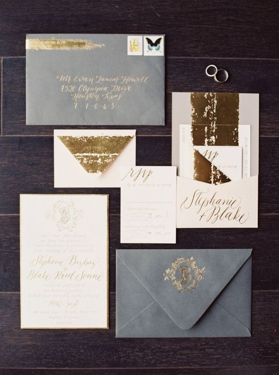a soft wedding invitation suite in grey, gold and white, with gold glitter