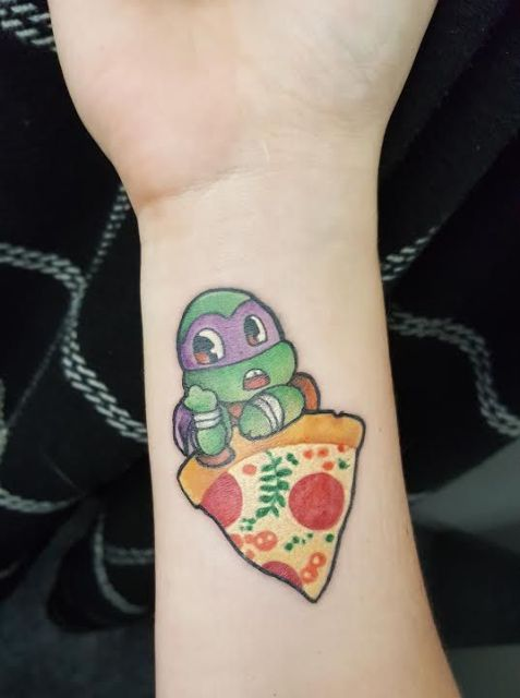 Ninja turtle tattoo on the forearm