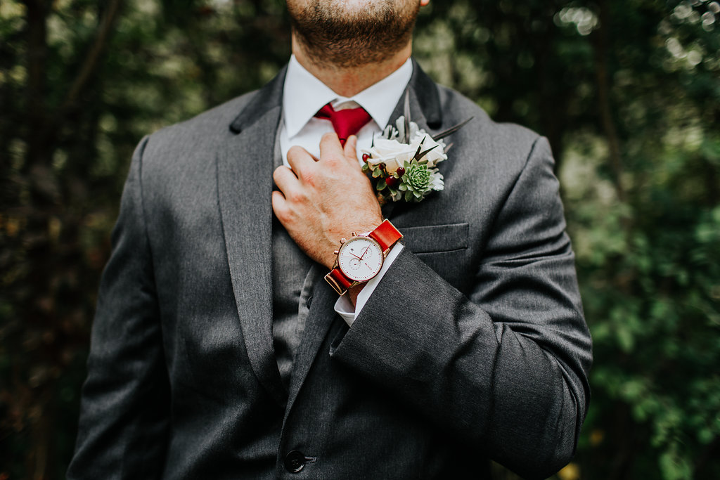 grooms with red accessories - http://ruffledblog.com/glam-autumn-wedding-at-belle-gardens