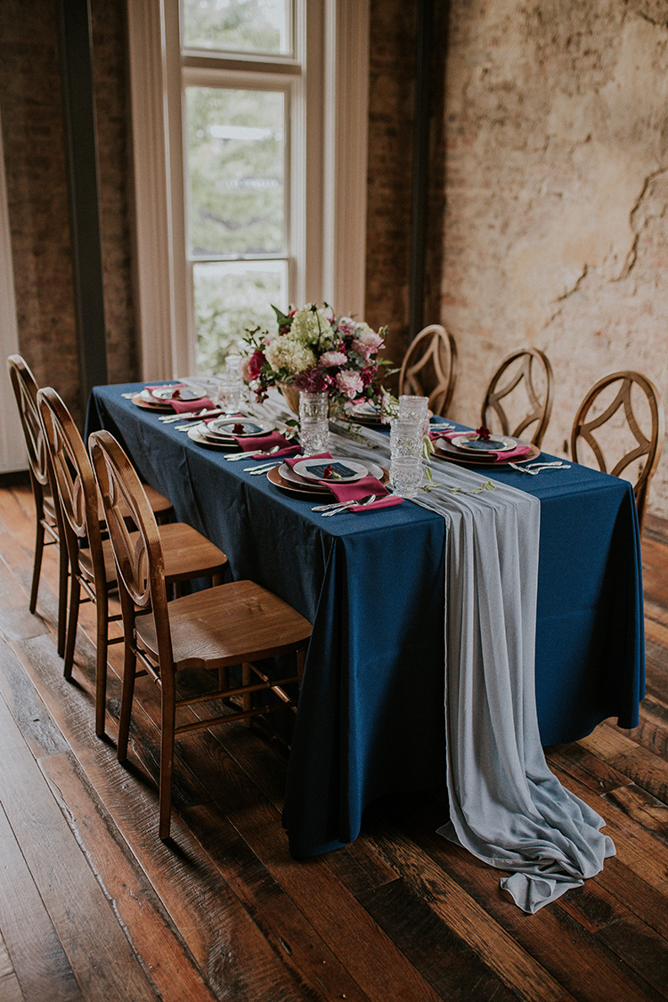 romantic blue tablescapes - http://ruffledblog.com/artist-inspired-wedding-ideas-with-oxblood-and-navy