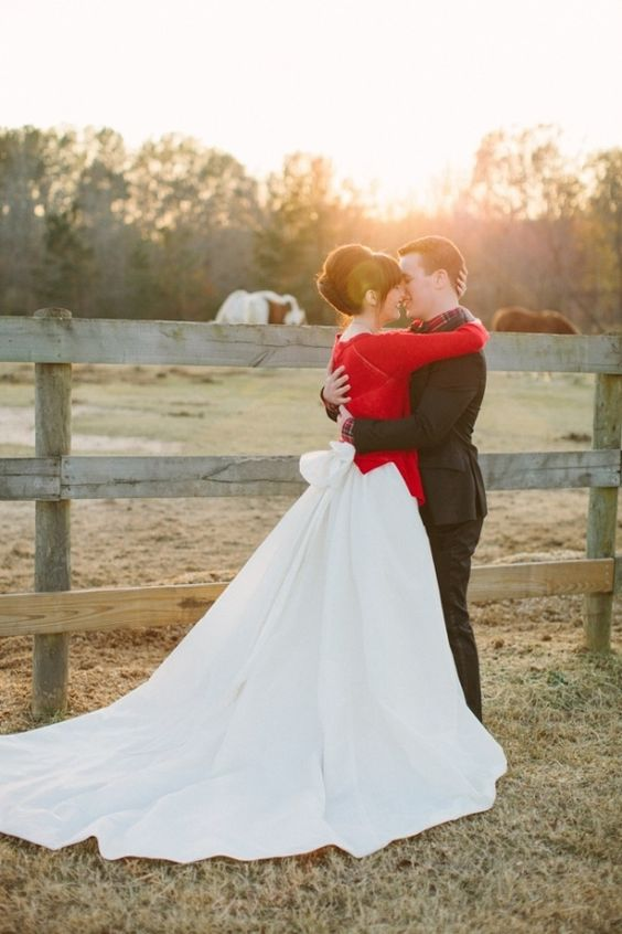 a red cardigan over the wedding dress is a chic idea to rock in the winter
