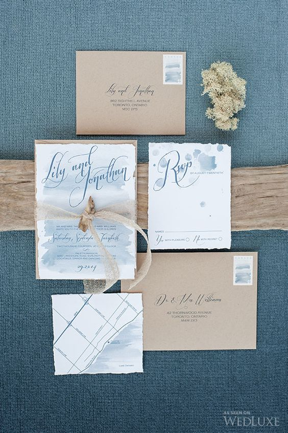 ethereal blue watercolor wedding invies with a raw edge and kraft paper envelopes