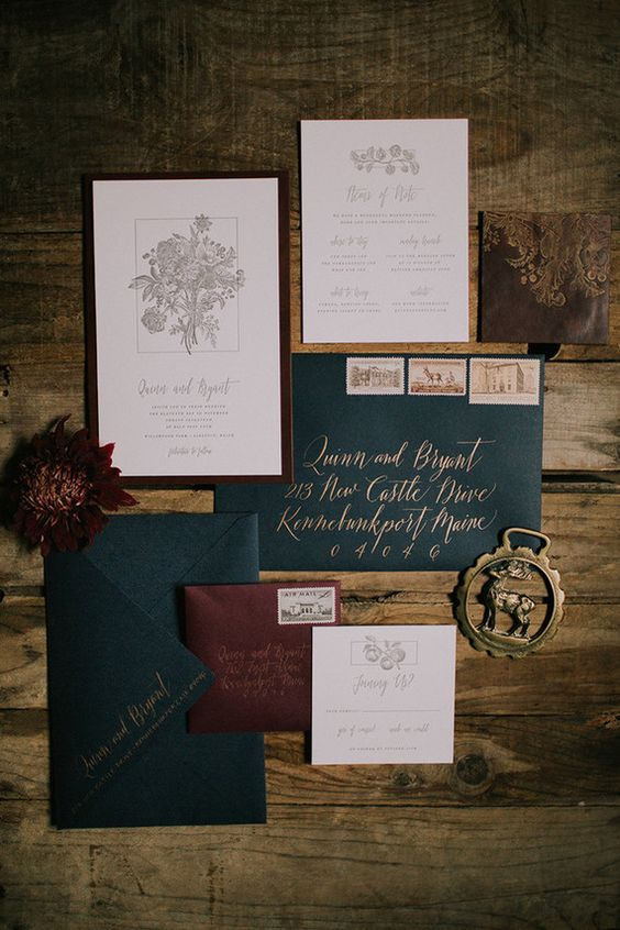 a vintage-inspired winter wedding invitation suite in burgundy, emerald and gold, which are traditional for Christmas