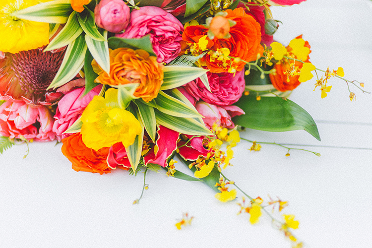 bright yellow and pink bouquets - http://ruffledblog.com/bright-colorful-destination-wedding-in-maui