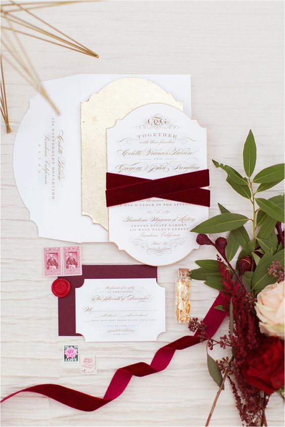 a neutral and burgundy wedidng invitation suite with velvet ribbons