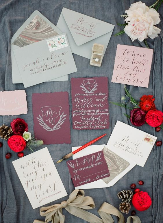 a Christmas inspired wedding invitaiton set in mint, burgundy, pink and neutrals with an agate print