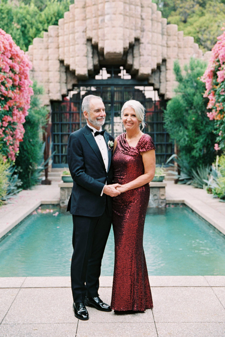 The groom's parents look really glam and chic - look at that red sequin dress