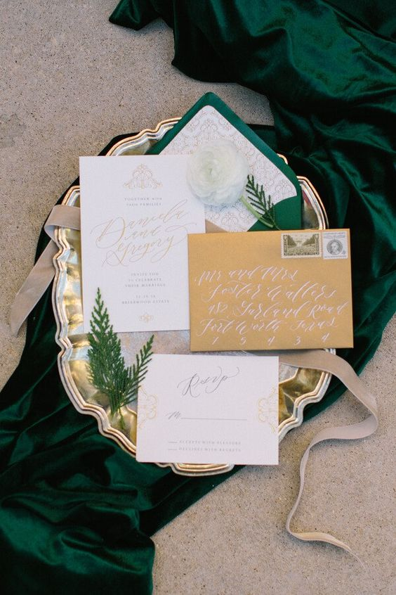 elegant gold and emerald wedding invitation suite with evergreens