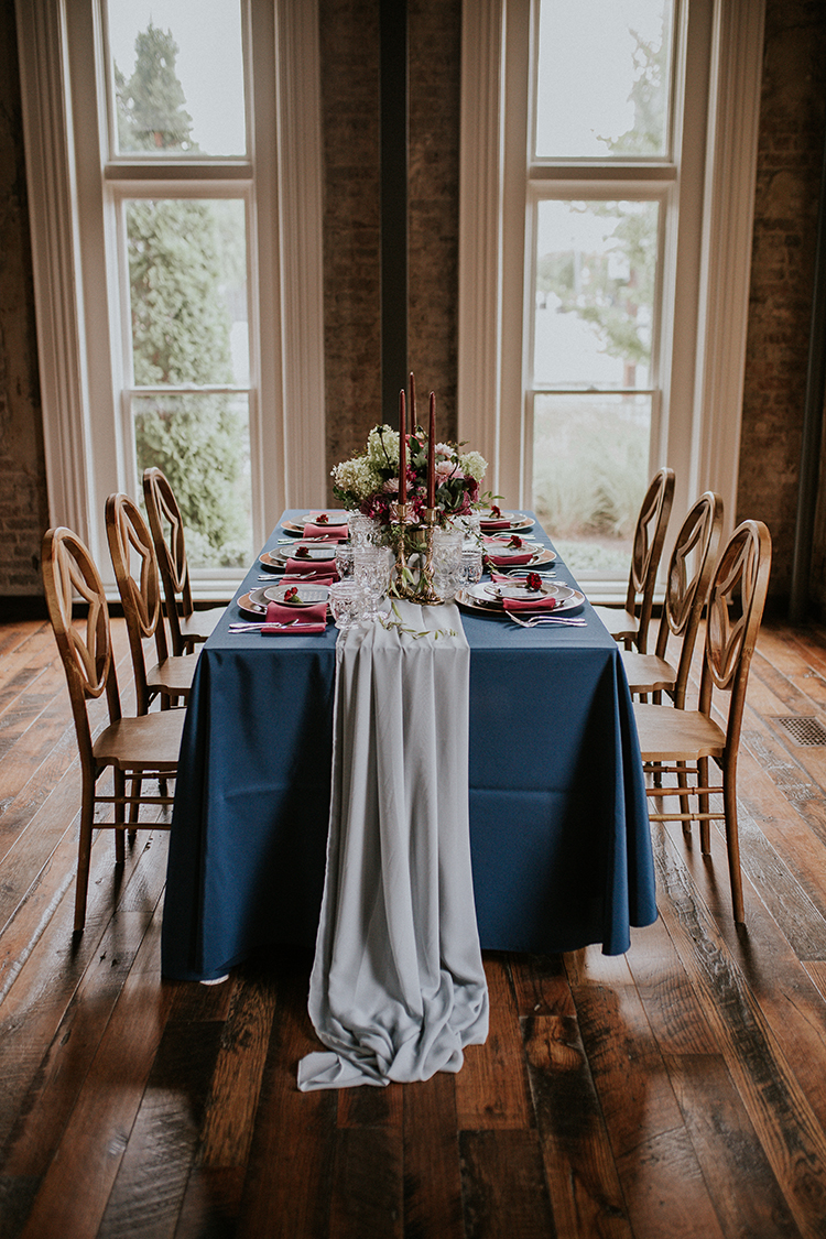 wedding tables with shades of blue - http://ruffledblog.com/artist-inspired-wedding-ideas-with-oxblood-and-navy
