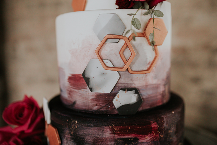 geometric wedding cakes - http://ruffledblog.com/artist-inspired-wedding-ideas-with-oxblood-and-navy