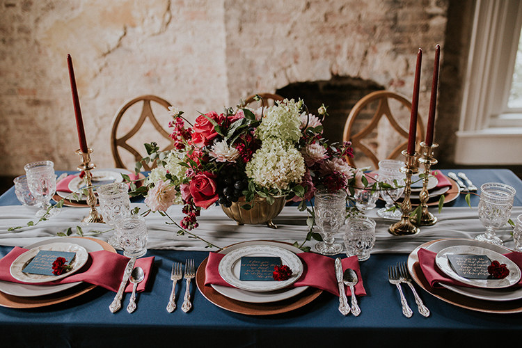 vintage inspired wedding tables - http://ruffledblog.com/artist-inspired-wedding-ideas-with-oxblood-and-navy